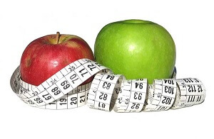 Red & Green apples with tape measure