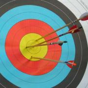 Hitting your target - arrows hitting the bullseye