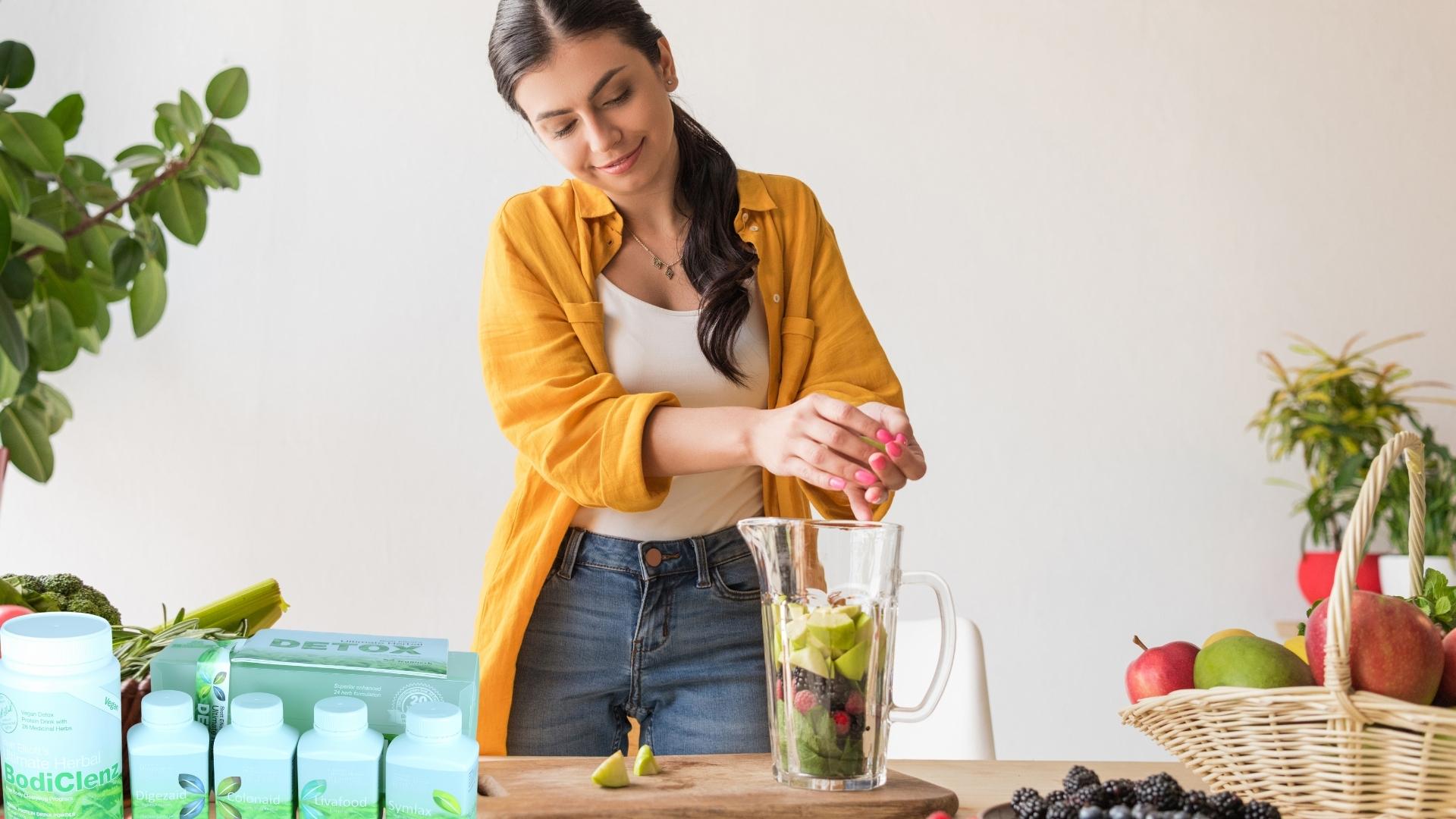 Woman Adding Vegetables in a Blender