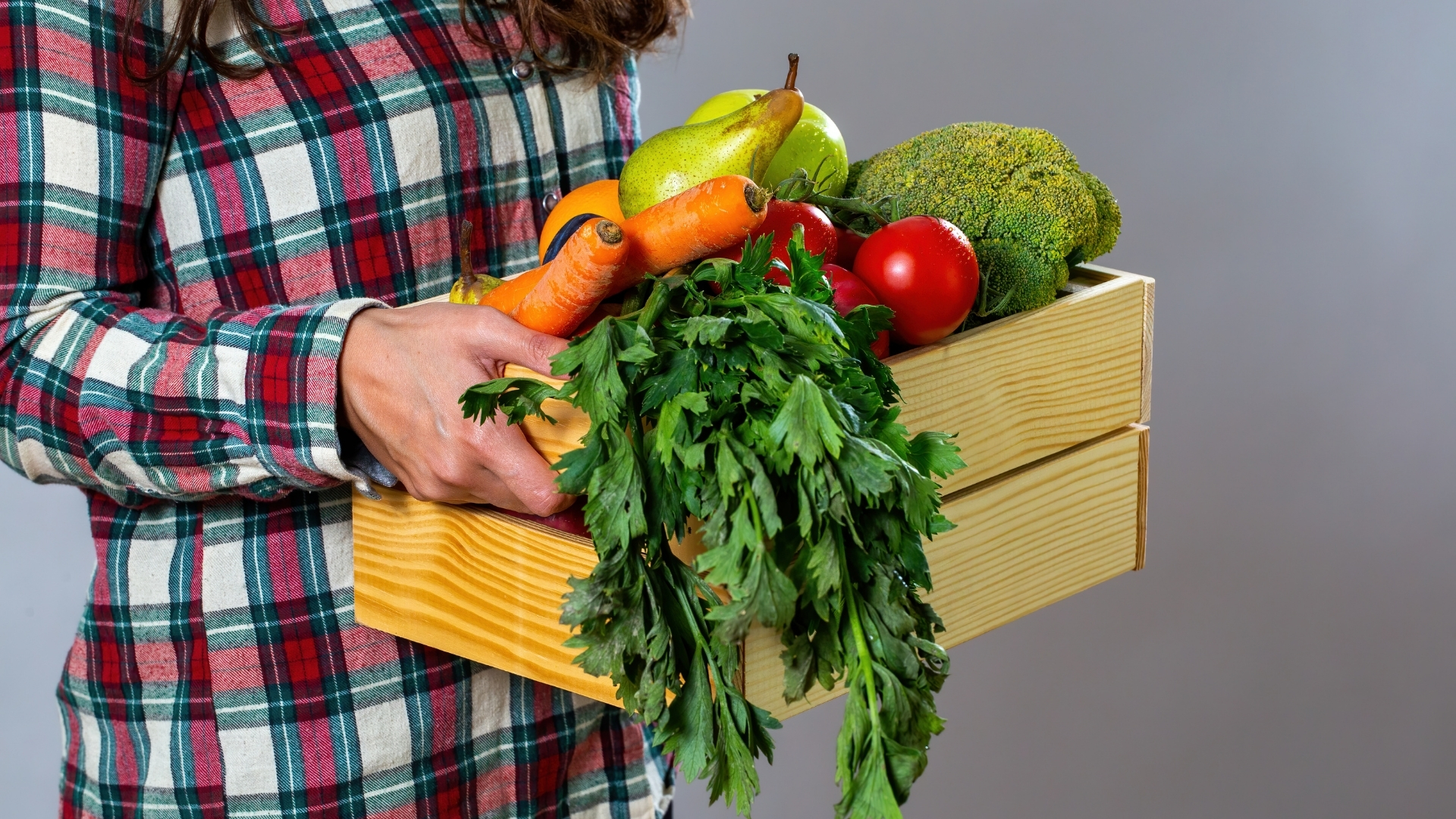 Woman Holding Assorted Vegetables in a Box